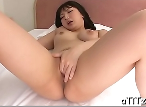 Asian babe with nice-looking boobs toys her wanton vagina