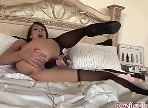Redhead MILF tolerable herself with dildos