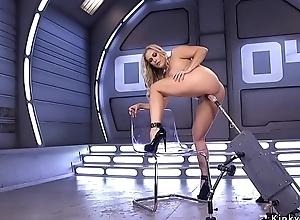 Huge tits blonde in high heels on apparatus