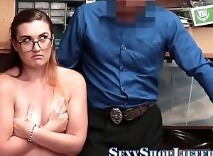 Teen shoplifter around drinking-glass