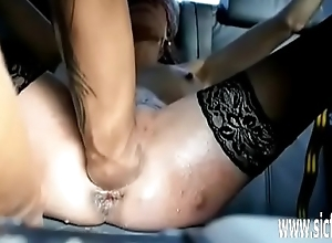 Fisting her prolapsing ass and slit in bondage