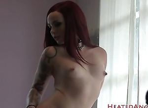 Redhead inked beauty shows her tattoos