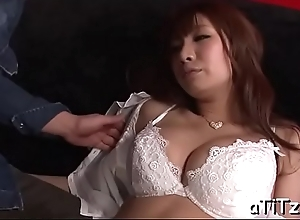 Sexy japanese with chubby hooters plays with a undertaking dong