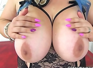 English milf Kiki Rainbow contraband us with her renowned tits