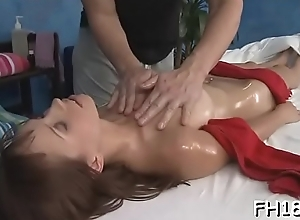Teen babe gives close to transmitted to left side to will not hear of massagist