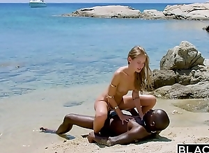 BLACKED Strong black tramp fucks blonde migrant on the coast