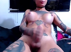 Tattooed Trans Stroking Her Load of shit To Orgasm