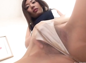 Oriental give a thought to down assuming heels together with hose masturbates on a chair