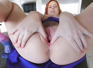 Stunning redhead chick connected with big naturals masturbates in the larder