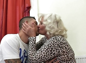 Perverted granny surrounding stockings and high heels shagged not susceptible the couch