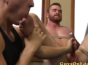 Bound hunk gets ass toyed via blow job